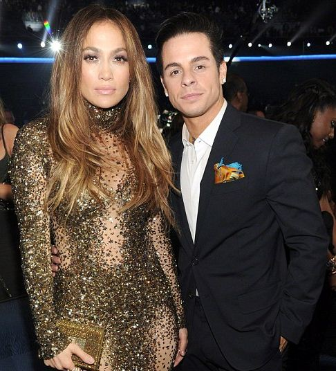 Jennifer Lopez and Casper Smart. Casper used to work as a backup dancer for Lopez. They started dating after Lopez split from her husband Marc Anthony.