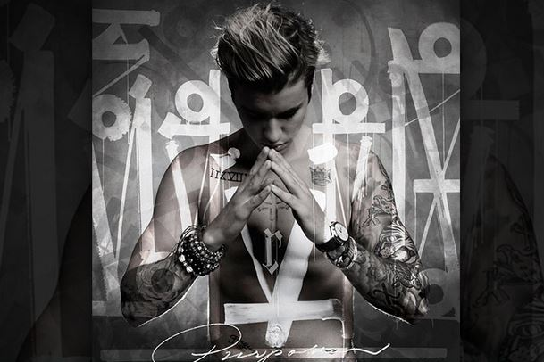 "Album cover for Justin Bieber's new album ""Purpose"". From the picture above, you can clearly see Bieber is topless and has a cross tattoo on his chest."