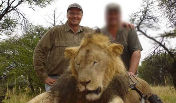 In this picture, American dentist Walter Palmer can be seen smiling as he poses with Cecil after killing it.